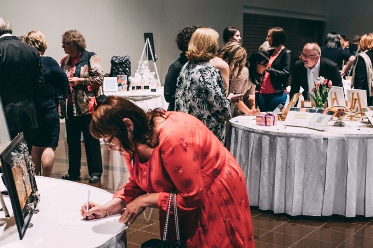 Silent auction tables at We Believe 2019