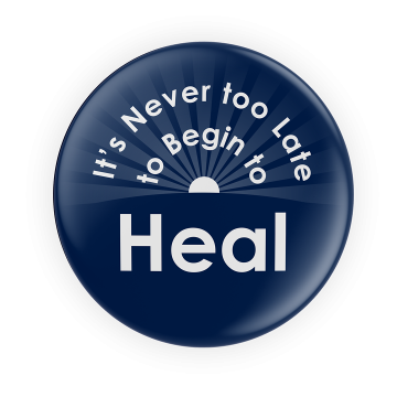 """Navy Blue Button That Reads """"It's Never Too Late To Begin To Heal"""" In White Font With A Sun With Rays Of Light In The Background."""
